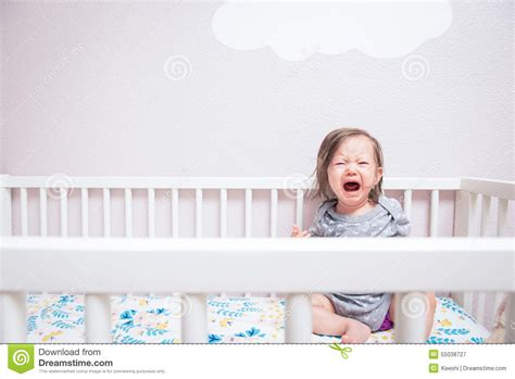 baby in crib baby in crib stock image image of waking