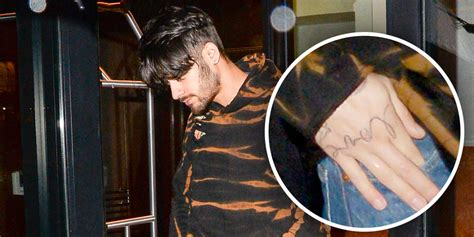 zayn malik unveils new tattoo and it looks like it could