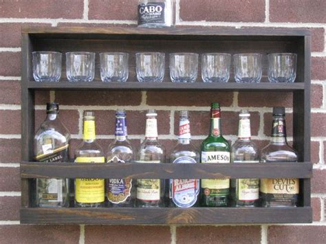 liquor wall rack hanging liquor cabinet rustic liquor rack by coolandusefulthings 85 00 someday house