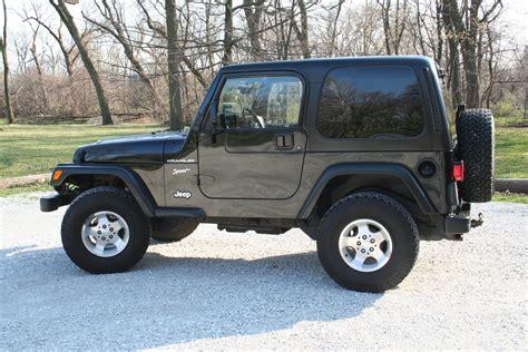 2002 Black Jeep Wrangler Mud Missile Mud Racing