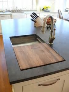 Prep sink on island with a built in cutting board this is genius i