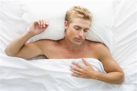 lying in my bed man lying in bed stock photo image of half horizontal