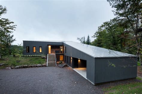 Home Floor Plans Single Level diagonal roofline defines extensive canadian hill lot home
