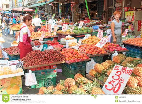 buy food selling and buying food in a traditional fruit and vegetable market of taiwan