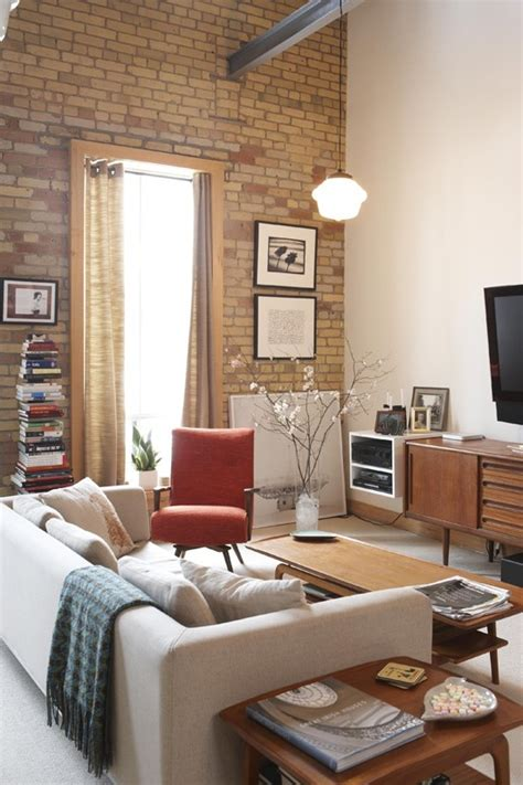 brick wall in living room 59 cool living rooms with brick walls digsdigs