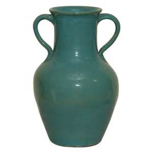 a green pottery vase signed pickfull for