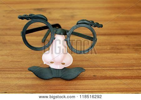goofy mask with eyeglasses nose and mustache stock photo