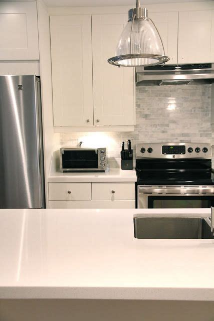 the backsplash tile and the white ikea cabinets