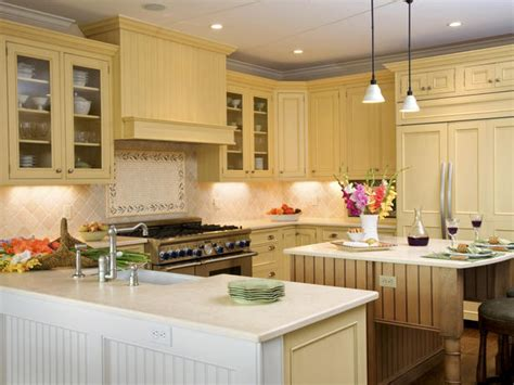 yellow and white kitchen cabinets charming country kitchen done in yellow hgtv