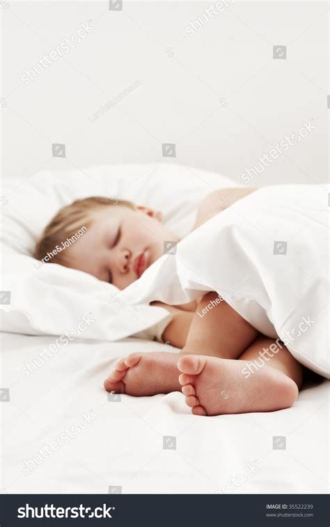 sleeping with baby in bed baby sleeping in bed stock photo 35522239 shutterstock
