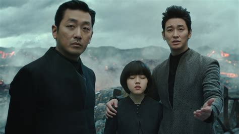 along with the gods film review along with the gods is a fantasy journey with c