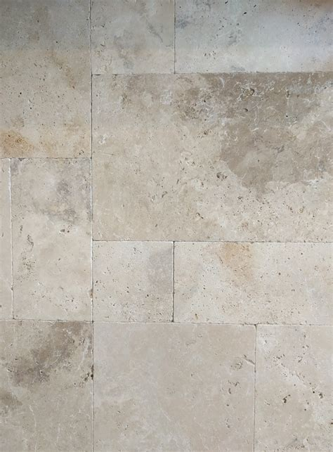 Mocha tumbled unfilled travertine french pattern tiles