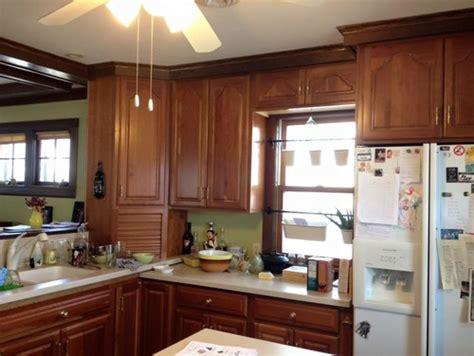 Trim Around Kitchen Cabinets Staining Or Painting Oak Trim In 1923 House Kitchen Cabinets