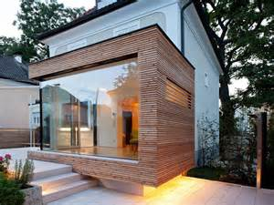 sleek glass and wood house extension with matching