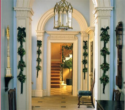 how to decorate a foyer in a home foyer blue white trim greenery holiday christmas