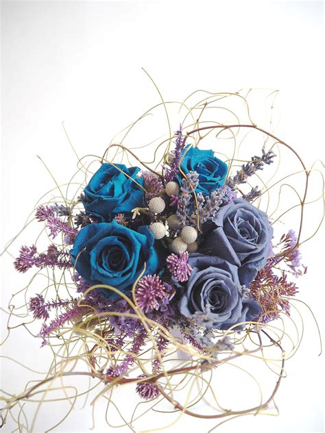 Box A Single Sky Blue Preserved Flower Represent Mystery bespoke preserved blue rosette bridal bouquet one olive