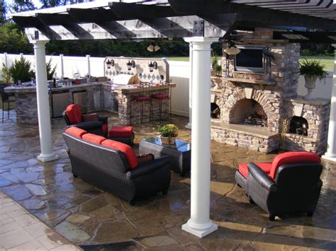 custom outdoor kitchen and fireplace traditional patio