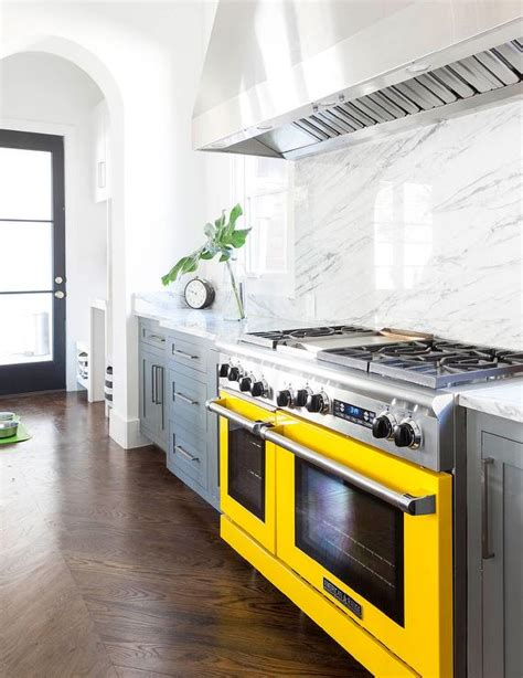 gray kitchen cabinets with yellow stove contemporary