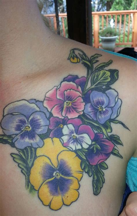 house of tattoo realistic pansies on shoulder by at house of