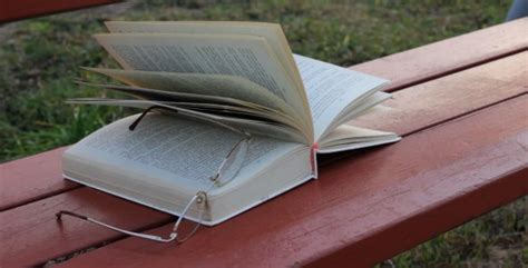 the bench book unfinished book with glasses on the bench by vintervarg