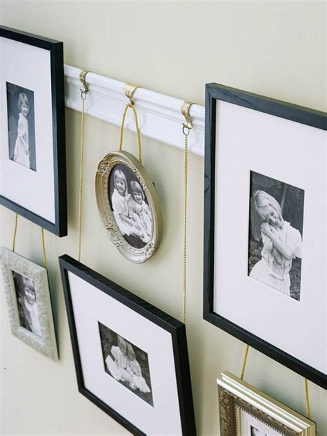hanging pictures without hooks photo display ideas hanging photos with ribbon string