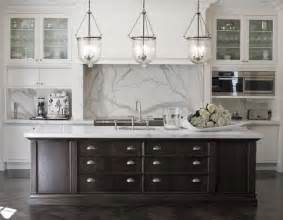 white kitchen dark island black and white kitchen marble benches and splash back