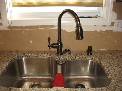 rubbed bronze kitchen sink faucet bronze kitchen sink faucets captainwalt