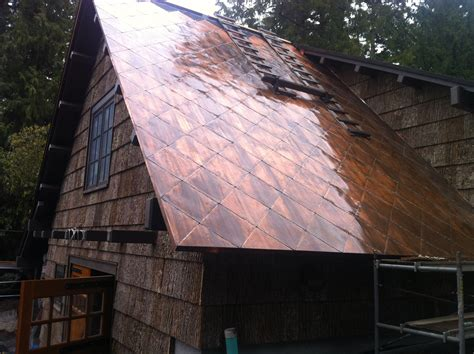 copper siding for houses house with bark siding also has a copper roof mildlyinteresting