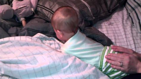 baby peek a boo with his baby boy plays peek a boo and giggles as he