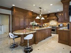 Circular Kitchen Island traditional wood island matching cabinetry throughout this kitchen