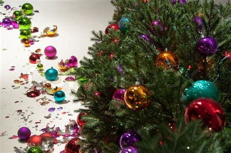 the shopping window features a fallen christmas tree with