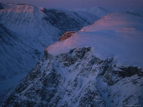 rugged snow view at twilight of baffin islands rugged snow covered mountains photographic print by gordon