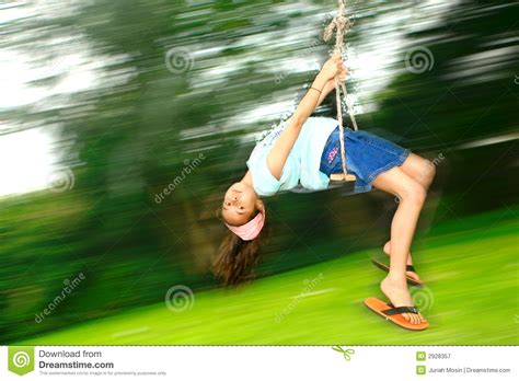swing fast young girl on fast swing royalty free stock photography
