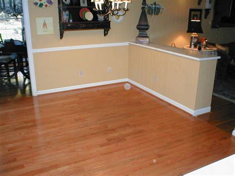 laminate floor removal and hardwood replacement accent