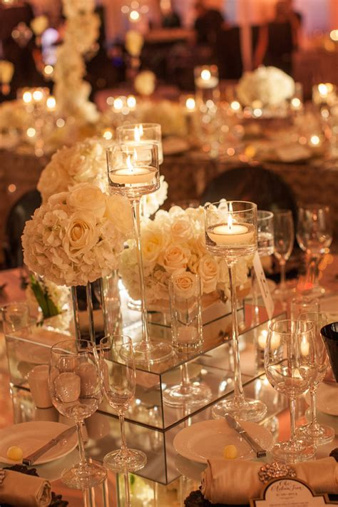 candle votives white roses and mirrored stands for
