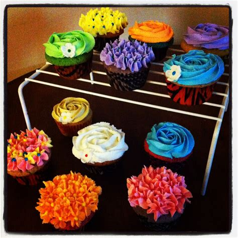 colored frosting baked designs by multi colored cupcakes