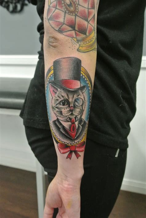 cool cartoon old cat in frame tattoo on outer