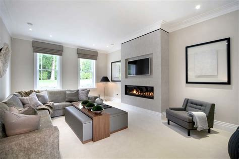 contemporary living rooms modern fireplace with tv above living room style with upholstered ottoman two way fireplace