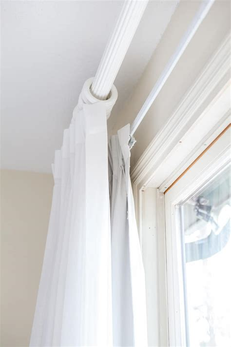 how to darken a room in search of solid white drapes in my own style