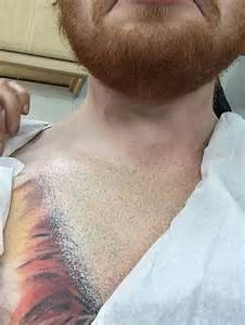 ed sheeran chest tattoo ed sheeran conceals lion chest tattoo in collared shirt