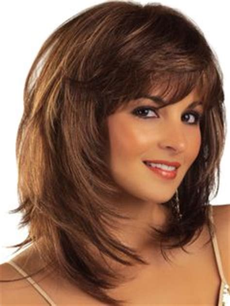 above shoulder shag layered bob with bangs cute medium length shag hairstyles for women over 50