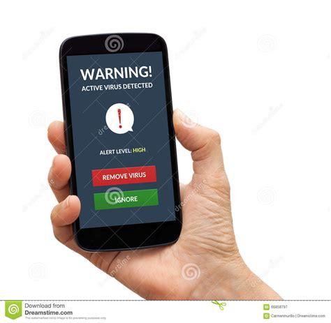 alert on mobile holding smart phone with virus alert on screen stock