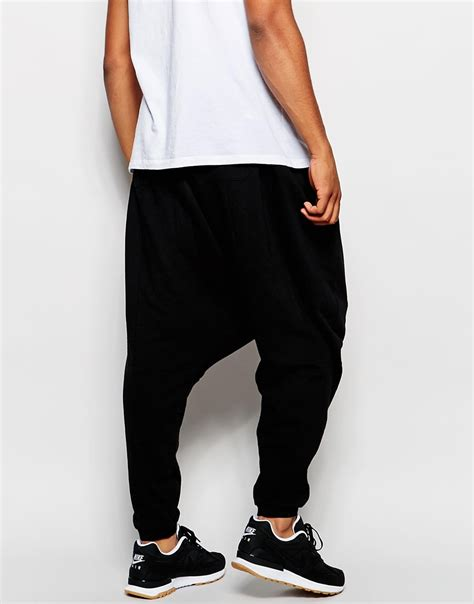Celana Jogger Brown Gold lyst asos drop crotch joggers with gold zips in black for