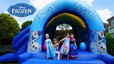 elsa and anna doll house frozen elsa and anna life size dolls playing outside giant inflatable frozen bouncy