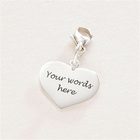 engraved silver charm someone remembered