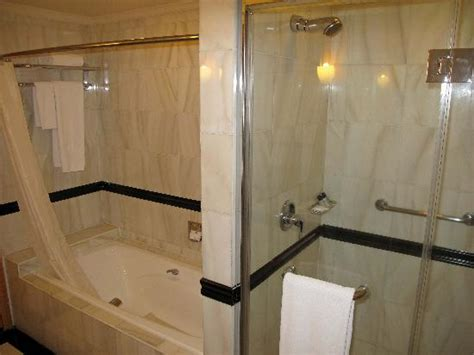 bathroom with separate shower and bathtub separate tub and shower in bathroom picture of renaissance riverside hotel saigon
