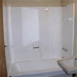 installing a frameless shower door in a fiberglass