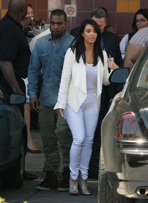 kanye in balmain shirt balmain yeezy 2 sneakers and in balenciaga sandals