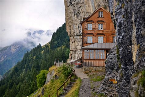house built into mountain the berggasthaus aescher is a hotel built into the swiss alps with breathtaking views