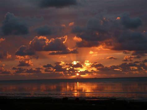 picture sunrise darkness water dawn dusk sun
